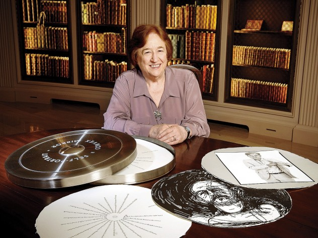 """Porter University Professor Helen Vendler in Houghton Library with a copy of the Arion Press edition of John Ashbery's """"Self-Portrait in a Convex Mirror"""""""