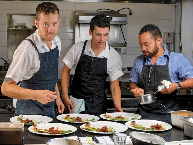 """Chef/owner Alex Crabb shares the open kitchen with fellow cooks Tyson Wardwell and Nathan """"Lazer"""" Phinisee."""