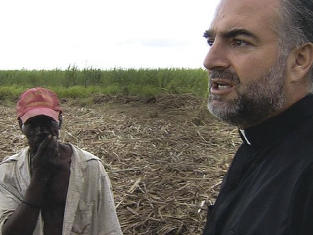 Father Christopher Hartley with a Haitian plantation worker