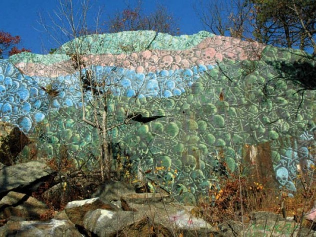 Spray-painted skull mural on climbable rockface near the Lynn Woods Reservation