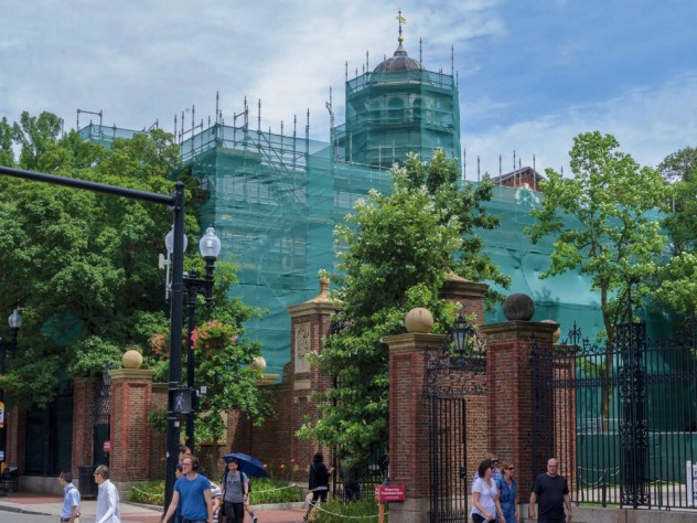 Photograph, renovating Harvard Hall, shown in protective construction wrapping