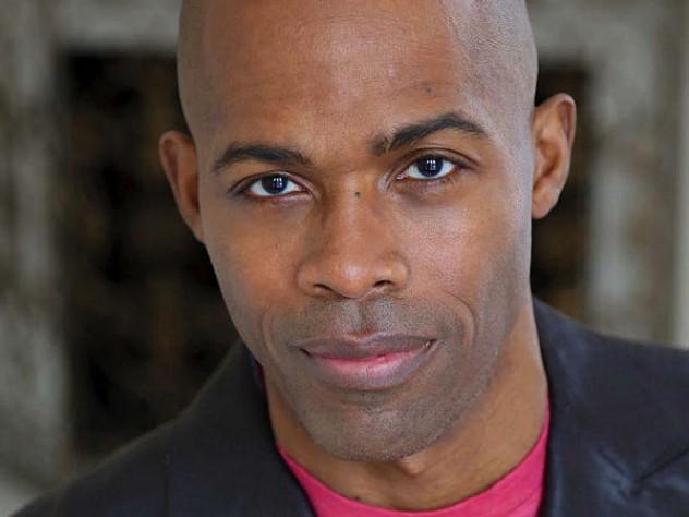 Headshot photograph of Ian K. Smith