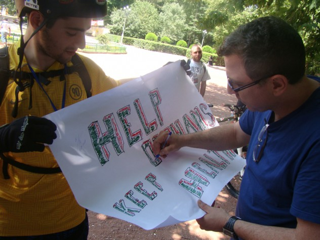 An ISS student gathers signatures in support of his team's cause during a day-long fieldtrip to Tbilisi.