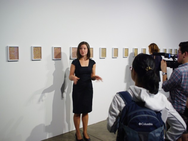 Jennifer Quick, a Ph.D. candidate in the department of the history of art and architecture, compares Michael Wang's micrograph images of artificially produced stem cells to the work of pointillist painter Georges Seurat.