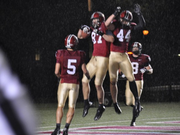 Levitation on a rainy night: Harvard receivers celebrated after a 35-yard touchdown pass to tight end Cameron Brate (87) in the opening period of the Crimson's 52-3 rout of Holy Cross. Quarterback Colton Chapple threw two scoring passes to Brate and one each to Ricky Zorn (5) and Kyle Juszczyk (44) in a 49-point first half.