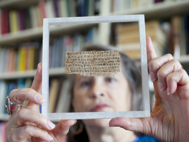 Hollis professor of divinity Karen L. King with the papyrus fragment on which is written the Gospel of Jesus's Wife.