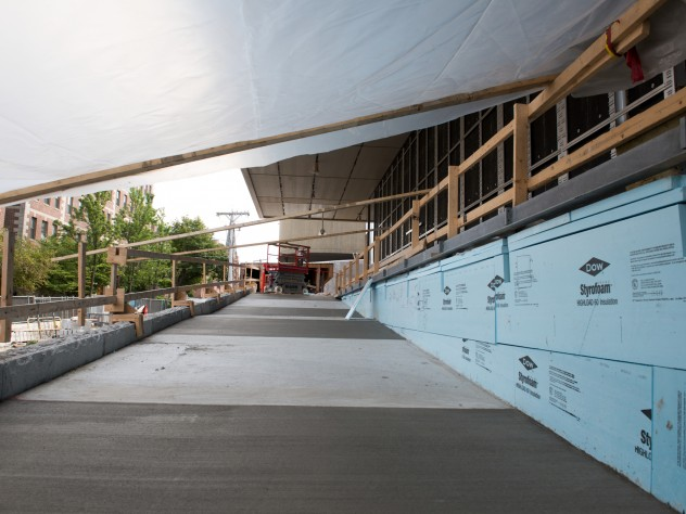 """The Prescott Street side of the museum includes a ramp that is an extension of the reverse ogee curve that transects the adjacent Le Corbusier-designed Carpenter Center. Architect Renzo Piano has referred to this effect as """"Le Corbusier putting his arm around the Fogg."""""""