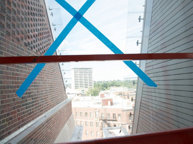 """A glass """"slot"""" separating the old Fogg building from the new admits welcome light to the interior. Brick from the old building (96 percent of its materials were ultimately recycled) was used to construct the wall seen here."""