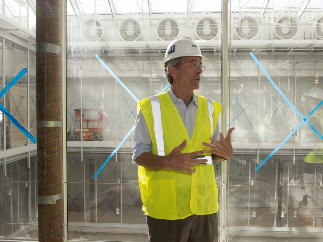 Cabot director of the Harvard Art Museums Thomas Lentz. Behind him is another example of architect Renzo Piano's penchant for exposing a building's systems: the exhaust fans for the atria.