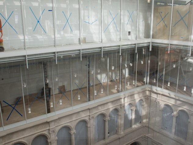 Glass walls in the upper stories of the courtyard afford oblique views into the art study and conservation spaces of this teaching museum, and allow natural light to diffuse through the interior.