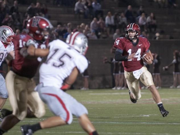 Hard-running quarterback Conner Hempel (14) gives Harvard's ground game an added dimension. Hempel ran the ball 11 times as Harvard overcame Brown, 41-23.
