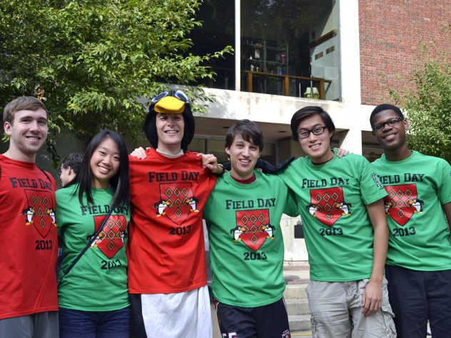 New Quincy House sophomores in green and veteran seniors in red (from left) Wes Welch, Kara Shen, Matthew Ackerman, Adam Al-Natsheh, Peter Lu, and Julian Guy are ready for Field Day in the O'Donnell Courtyard.