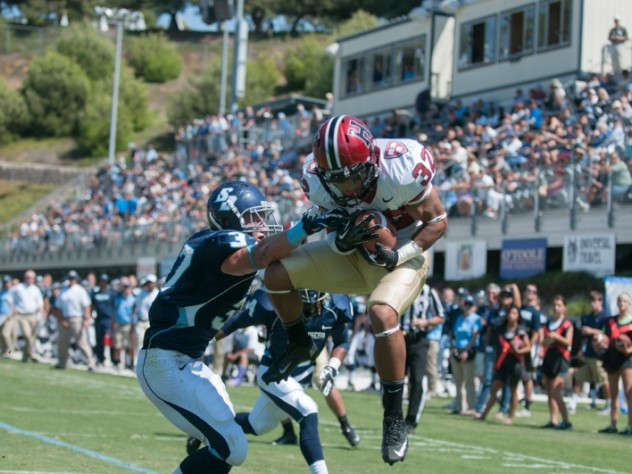 Hempel's first touchdown pass went to sophomore wide receiver Andrew Fischer (32), who beat USD safety Robbie Beathard (37) to the ball. As a two-way player at Diamond Ranch High School, in Pomona, Fischer won California's High School Heisman Award as the state's top scholar-athlete.