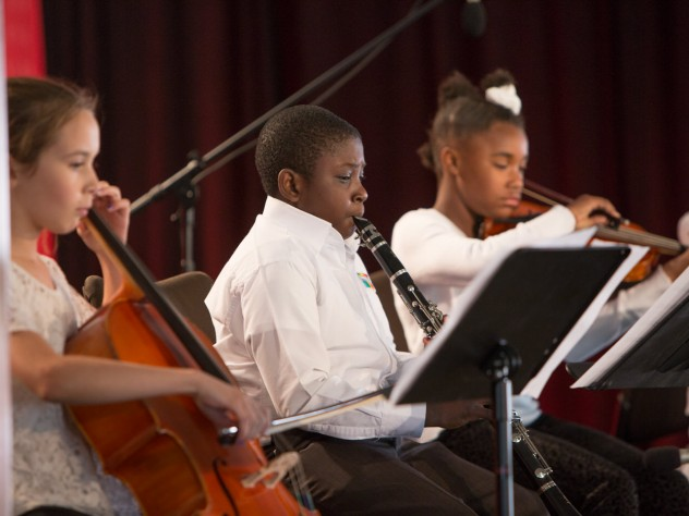"""A quartet of instrumentalists and trio of singers from Conservatory Lab Charter School performed arrangements of """"Amazing Grace"""" and """"Feelin' Good"""" before President Faust spoke."""