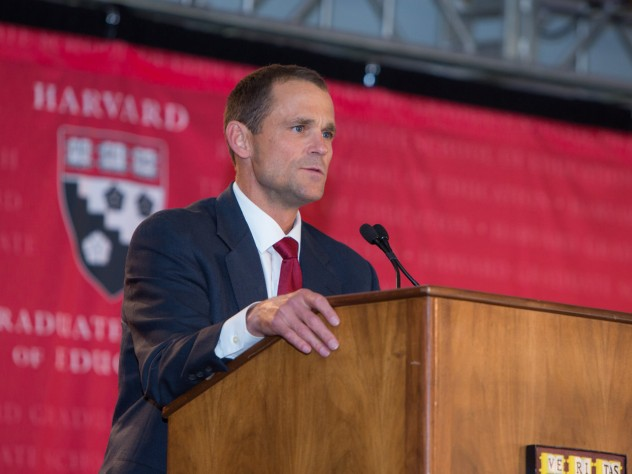 Dean James Ryan speaks to the more than 1,300 attendees at the HGSE campaign launch, held under a tent in Radcliffe Yard.