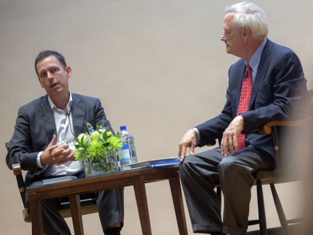 Entrepreneur Peter Thiel (left) and professor of business administration William A. Sahlman discuss the power of monopolies at an event in Burden Hall.