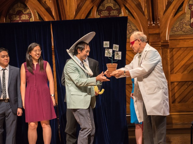 Physics winners David Hu and his team receive their prize from Dudley Herschbach.