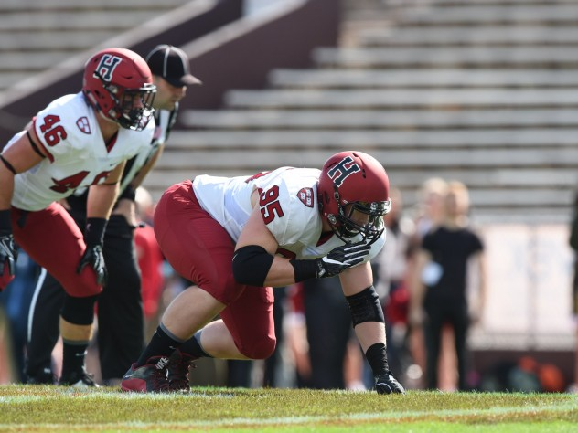 Defensive tackle Miles McCollum (95) and linebacker Sean Mackin were part of a Crimson defense that stingily held Brown to 74 net rushing yards.