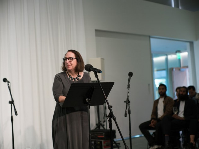 Associate provost for arts and culture Lori Gross at the microphone