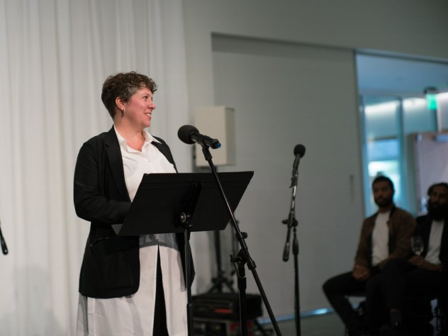 ArtLab director Bree Edwards at the microphone
