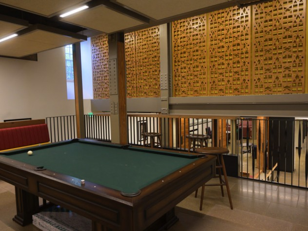 A multi-level common with a pool table in front
