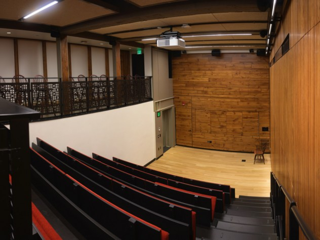 A tiered, downward-sloped theatre with 64 seats
