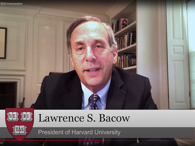 Photo of Harvard president Lawrence Bacow in his office