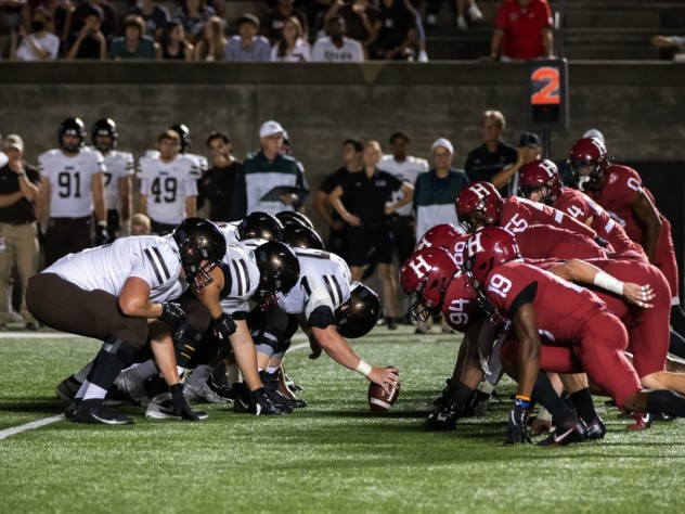 The Harvard defense lines up against the Brown offense.