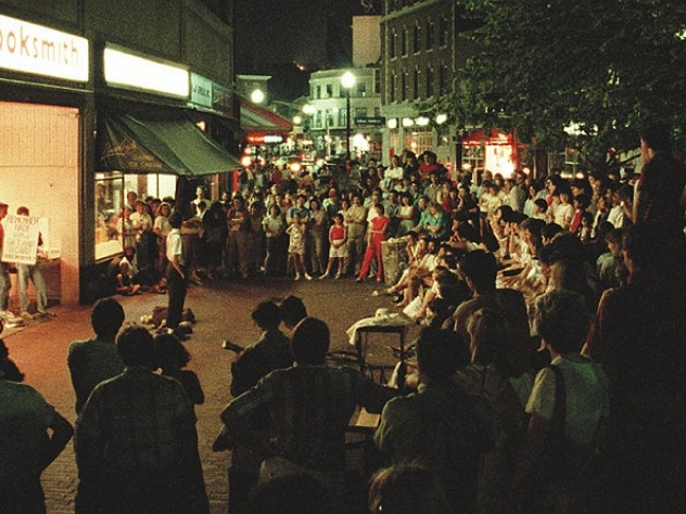 Cruising the Square: A summer crowd watches a street performer in 1987.