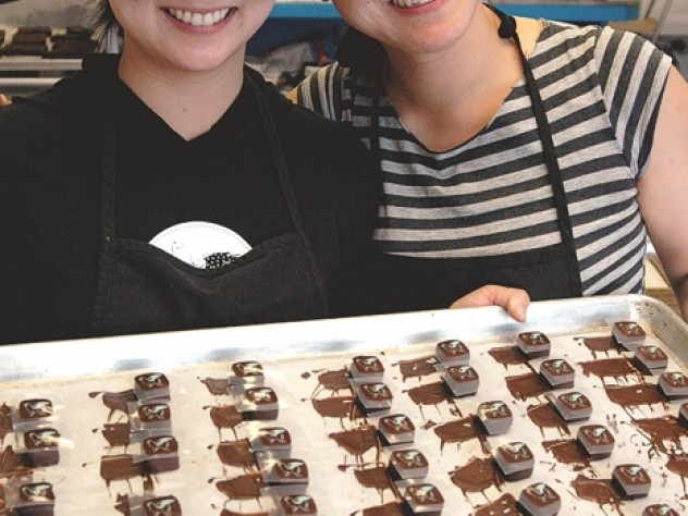 "The sisters with their ""Duchess of Earl"" Earl Grey-flavored truffles.  After dipping, they push each one to the side to prevent a trailing  ""foot"" of excess dipped chocolate."