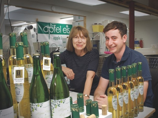 After their apple ice wine has fermented for three months, Margot and Leif Holtzman fill and seal each bottle by hand.