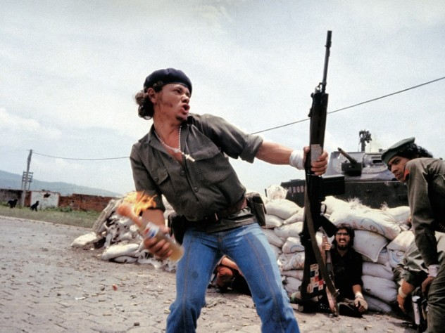 "Molotov Man: Sandinista fighter Pablo Araùz (known as ""Bareta"") at the walls of the National Guard headquarters, Estelí,  Nicaragua, 1979. From <em>Pictures from a Revolution</em>"