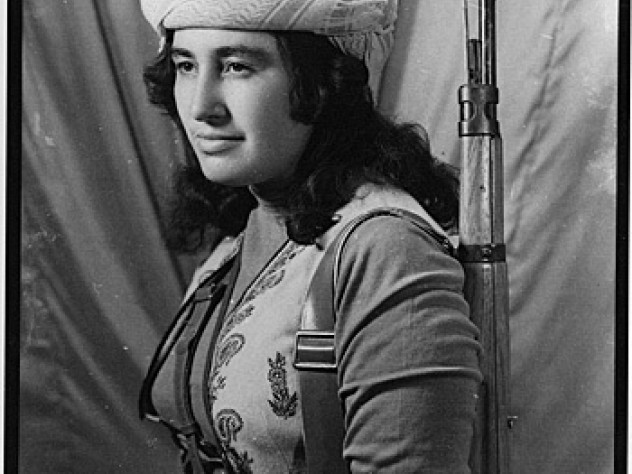"Margaret George, photographed by Zaher Rashid. George (1941-1969) was an Assyrian Christian who fought with the Kurdish resistance movement known as the Peshmerga (""those who face death"") in northern Iraq. ""A lot of people came and asked for photographs of Margaret, especially the Kurds of Iran. Margaret has been famous since the sixties, and her photograph is everywhere. The Peshmerga in the mountains keep photographs of Margaret."" —Zaher Rashid interview, 1993"