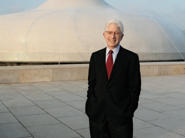 James Snyder stands in front of the exterior dome of the Israel Museum's Shrine of the Book, which houses the Dead Sea Scrolls.