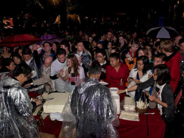 """The crowds were appeased after receiving their """"precious bricks"""" of red velvet cake."""