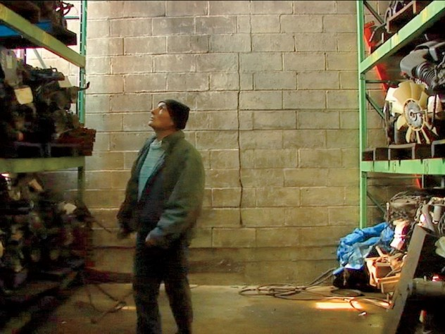 Joe, a quintessential New Yorker and central figure in <i>Foreign Parts,</i> takes a walking tour of a warehouse stocked with automobile parts.