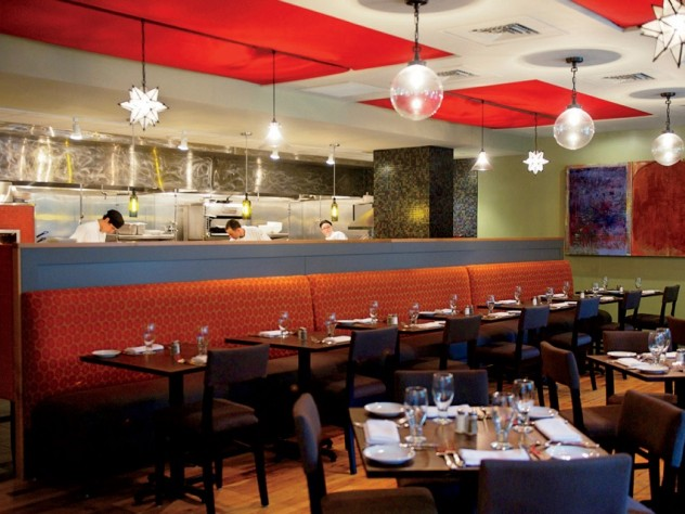 Evoo's earthy food is served in a modern, open interior with a view of the kitchen.