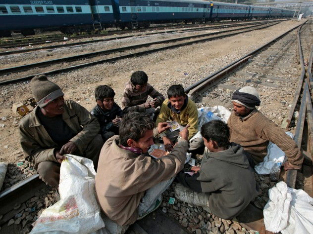 It's a hard life for boys who fall into this livelihood. They socialize with older men, gambling to pass the time between trains and using drugs to ease the shame of poverty and the pain of hunger and cold.