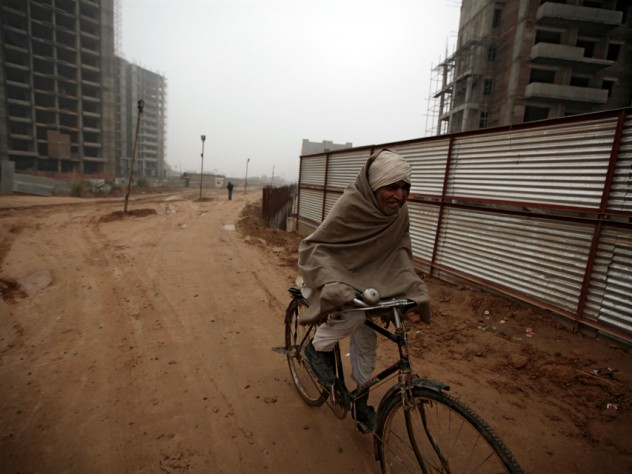 This construction site in Gurgaon, near Delhi, is part of India's building boom—and it is already home to construction workers, most of whom come from rural areas and have families in tow.