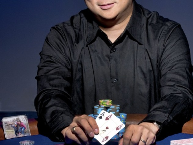 Bernard Lee at the card table, with a picture of his children beside him, as usual