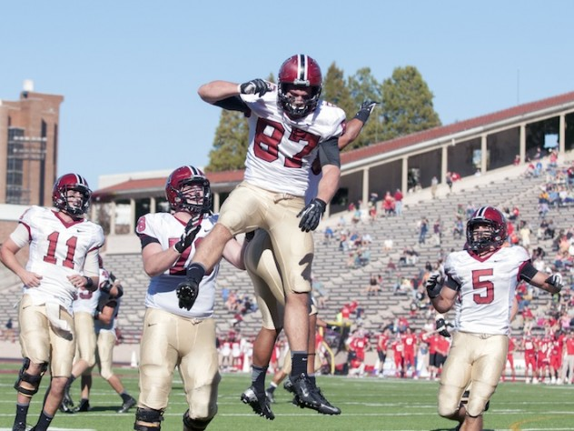 Tight end Cameron Brate (87) went airborne after catching a late-game touchdown pass that locked up the Harvard win. Behind him are quarterback Michael Pruneau (11), tackle Cole Toner (78), and wideout Ricky Zorn (5). Zorn led the Crimson receiving corps with seven catches for 64 yards.
