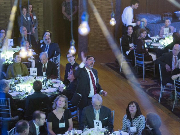 Donner professor of science John Huth, who co-directs the science program of the Radcliffe Institute's Academic Ventures initiative, guided the dinner audience around an overhead display of lights arranged to mimic constellations.