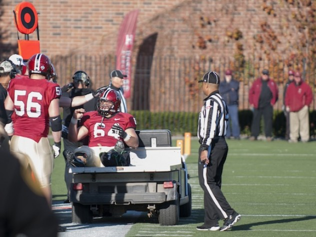 Senior David Leopard, the team's only center with varsity-level experience, gave a thumbs-up sign as he left the field with a broken ankle late in the third period of the Princeton game. He was replaced at center by guard Nick Easton, who had never played the position.