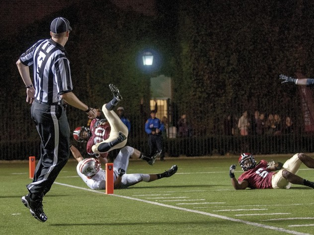Safety Jaron Wilson dove into the end zone, vaulting over Bruin halfback Andrew Coke, to finish off a 51-yard interception return in the Brown game. Cornerback Brian Owusu (6, at right) had thrown a crushing block on Coke just in front of the goal line.
