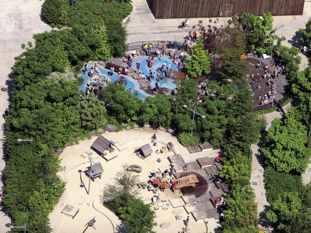 Pier 6: an aerial view of the playground, with greenery and water and sand play features for New York children of all ages