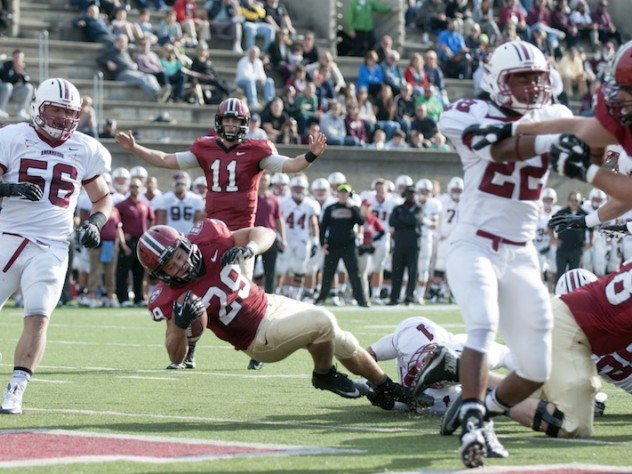Tailback Paul Stanton Jr. (29) had a career day against Lafayette, rushing for 113 yards and two short-yardage touchdowns. Behind him is quarterback Michael Pruneau (11). The Lafayette defenders are end James Coscia (56), safety Jared Roberts (1), and cornerback Draeland James (22).