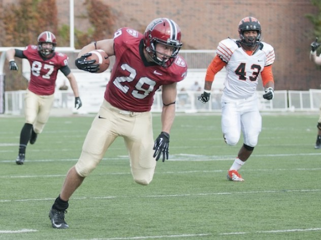 Halfback Paul Stanton Jr. (29) led the rushing attack against Princeton, carrying 12 times for 91 yards and two touchdowns. His first score came on a 60-yard breakaway that helped Harvard to a 14-13 lead in the game's second quarter. The pursuing Tiger is linebacker Jason Ray.