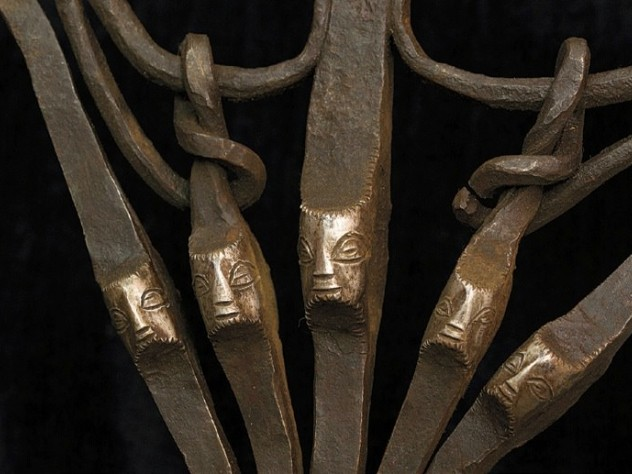 Faces appear on part of an iron axe (Zaire)