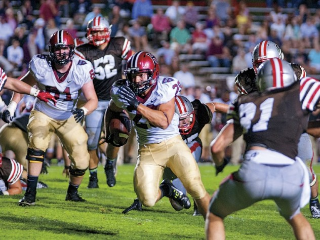 Ever in the Brown backfield, Scott Peters (44) and Connor Sheehan (50) headed a hard-hitting crew that limited the Bears to 88 yards on the ground.