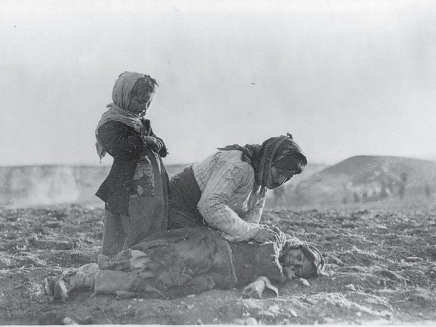 woman and dead child near Aleppo, Syria (undated)